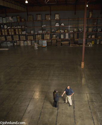 High angle view of businesspeople shaking hands in warehouse